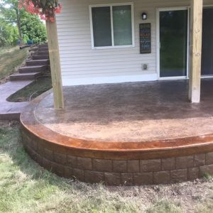 Stamped concrete back porch and walkway to front of house