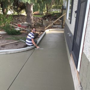 a Pete's Concrete worker finishing the broom finished concrete