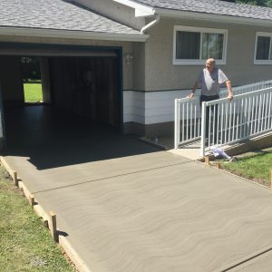 a freshly completed broom finished driveway and garage pad