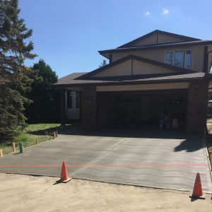 A double car driveway and front walkway broom finished concrete